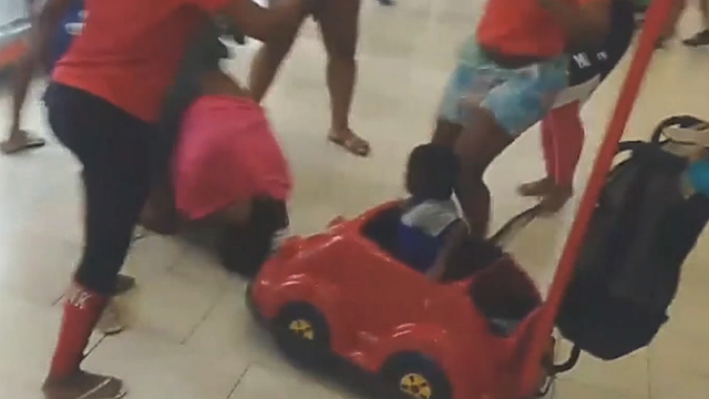 Child in stroller caught up in brawl at mall
