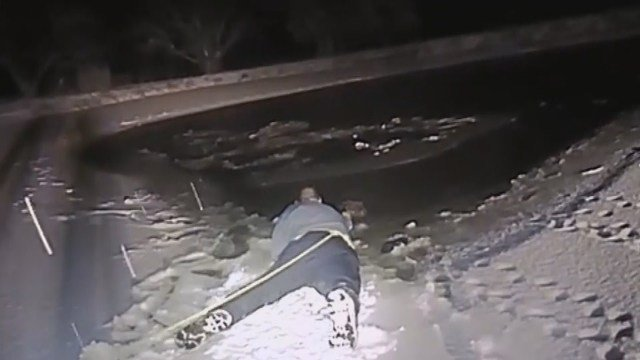 Dramatic video shows officers save dog from frozen pond