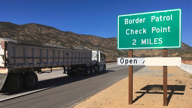 In this Thursday, Dec. 14, 2017 photo, a sign warns of the upcoming California Pine Valley checkpoint, on the main route from Arizona to San Diego. (AP Photo/Elliot Spagat)