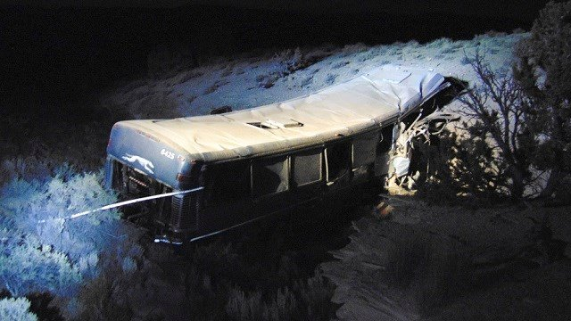 (Utah Department of Public Safety via AP) The aftermath of a late-Sunday Greyhound bus crash is seen on Monday, Jan. 1, 2018 in Emery County. A 13-year-old girl died and 11 others were hospitalized when the bus went off the freeway and crashed into...