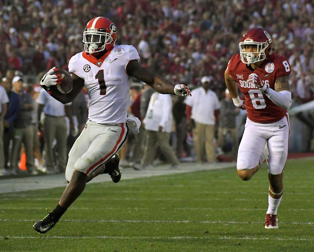Georgia running back Sony Michel (1) runs for a touchdown past Oklahoma safety Kahlil Haughton (8) during the second half of the Rose Bowl NCAA college football game, Monday, Jan. 1, 2018, in Pasadena, Calif. (AP Photo/Mark J. Terrill)