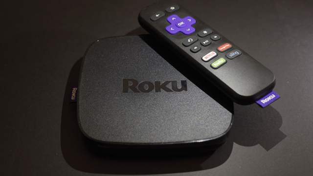 Roku plans to add a voice-controlled digital assistant to expanding lineup of online video players in an attempt to catch up with Google, Apple and Amazon. (AP Photo/Patrick Sison, File)