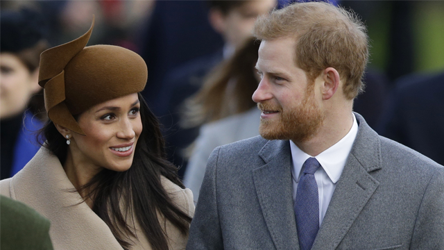 Britain's Prince Harry and his fiancee Meghan Markle attend the traditional Christmas Day service at St. Mary Magdalene Church in Sandringham England