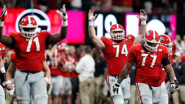 Georgia react after a replay confirmed a touchdown during the second half of the NCAA college football playoff championship game against Alabama Monday, Jan. 8, 2018, in Atlanta. (AP Photo/David Goldman)
