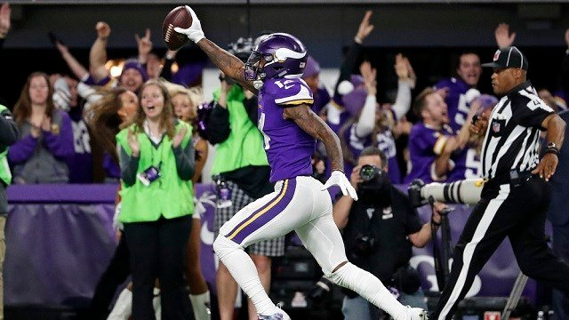 Minnesota Vikings wide receiver Stefon Riggs (14) runs in for a game winning touchdown against the New Orleans Saints during the second half of an NFL divisional football playoff game in Minneapolis, Sunday, Jan. 14, 2018. The Vikings defeated the Saints