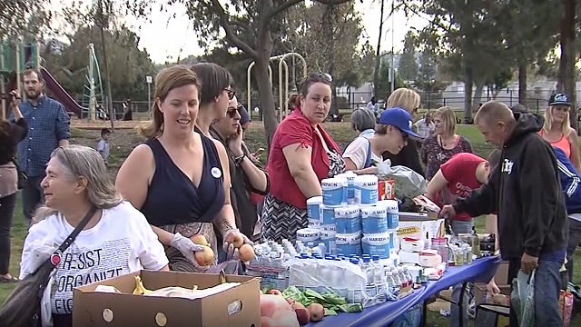 About a dozen people were arrested Sunday evening in El Cajon for feeding the local homeless population. (Source: KUSI via CNN)