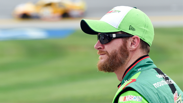Sprint Cup Series driver Dale Earnhardt Jr. (88) watches qualifying for the NASCAR Sprint Cup Series auto race at Talladega Superspeedway Saturday, Oct. 24, 2015, in Talladega, Ala. (AP Photo/ Mark Almond )