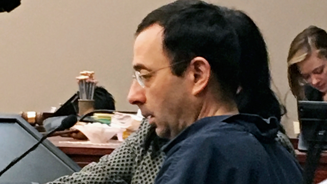 Former Michigan sports doctor Larry Nassar sits in court Tuesday, Jan. 16, 2018, in Lansing, Mich., at the start of his four-day sentencing hearing for sexually assaulting young gymnasts. (AP Photo/David Eggert)