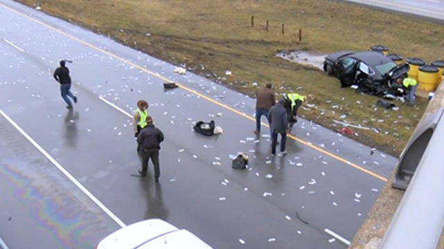 Crash sends cash across interstate highway