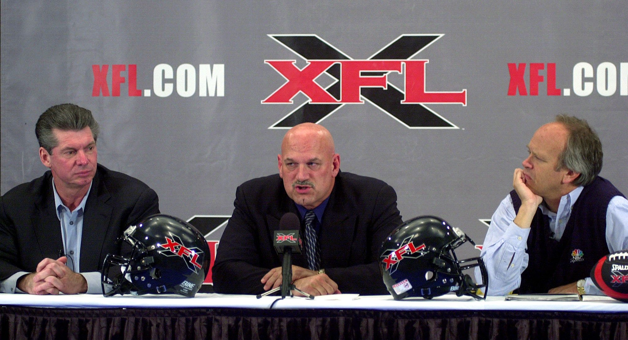 (AP Photo/Jim Mone) Vince McMahon, left, chairman of the World Wrestling Federation and NBC Sports chairman Dick Ebersol, right, listen as Minnesota Gov. Jesse Ventura talks about the new XFL football league during a press conference, Thursday, Nov. 16...