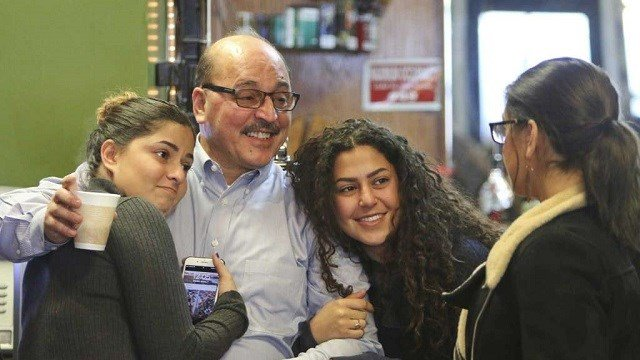(Robert K. Yosay/The Vindicator via AP) In this Jan. 2, 2018, photo, owner of Downtown Circle Convenience and Deli Amer Adi Othman, known locally as Al Adi, second from left, stands with his daughters in Youngstown, Ohio. U.S. Immigration and Customs...