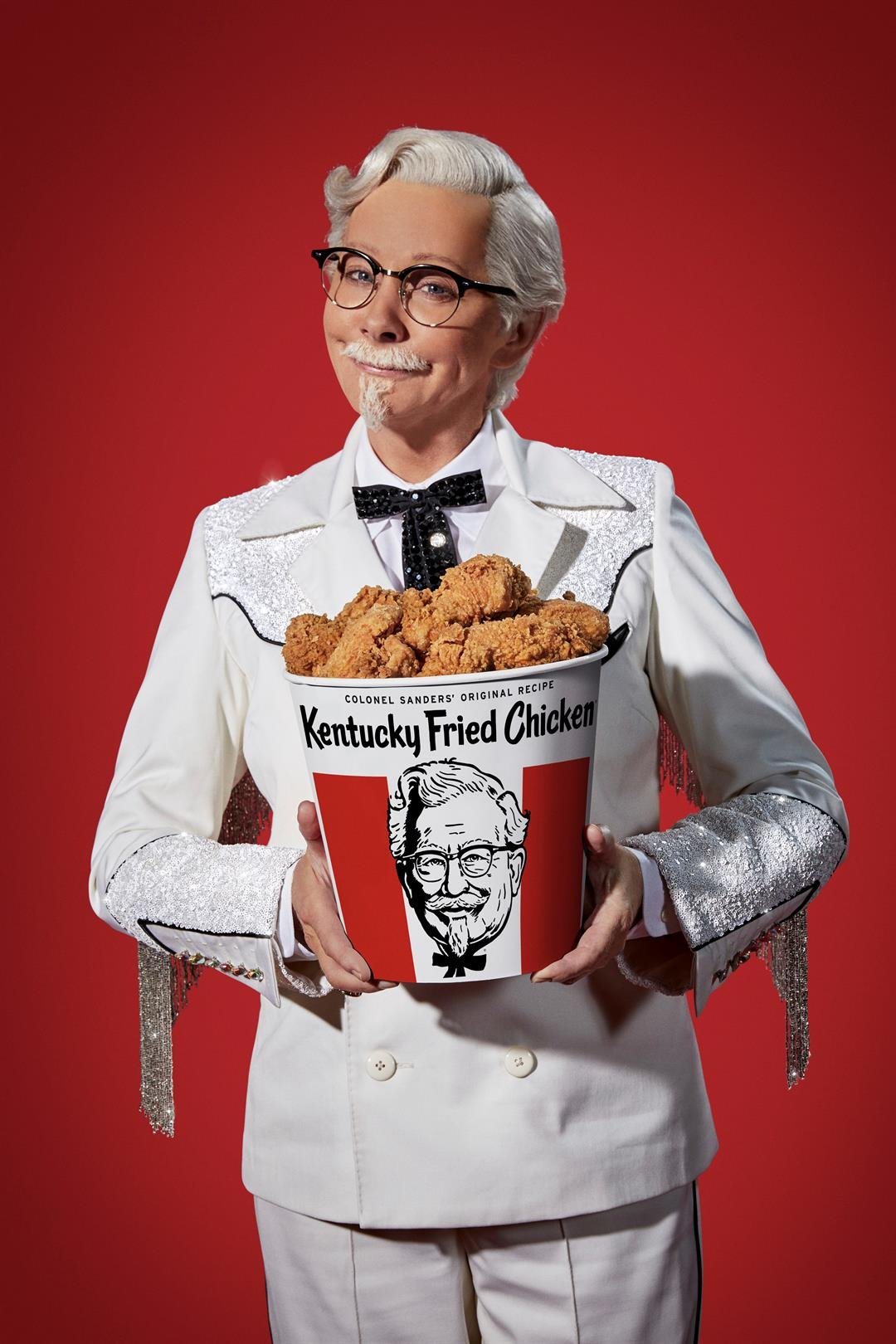 This photo provided by KFC shows singer Reba McEntire as KFC's Colonel Sanders. A rotating cast of famous names have portrayed the Colonel since 2015, but McEntire is the first female celebrity to do it, and the first musician. (Courtesy of KFC via AP)