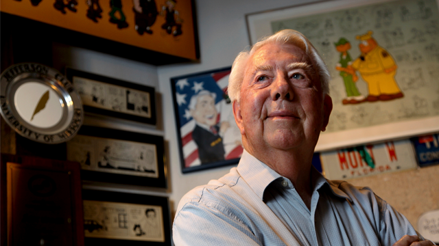 Mort Walker, the artist and author of the Beetle Bailey comic strip, stands in his studio in Stamford, Conn. On Saturday, Jan. 27, 2018, a family member said the comic strip artist has died. He was 94. (AP Photo/Craig Ruttle)