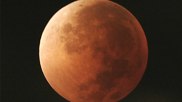 In this Aug. 28, 2007, file photo, the moon takes on different orange tones during a lunar eclipse seen from Mexico City. (AP Photo/Marco Ugarte, File)