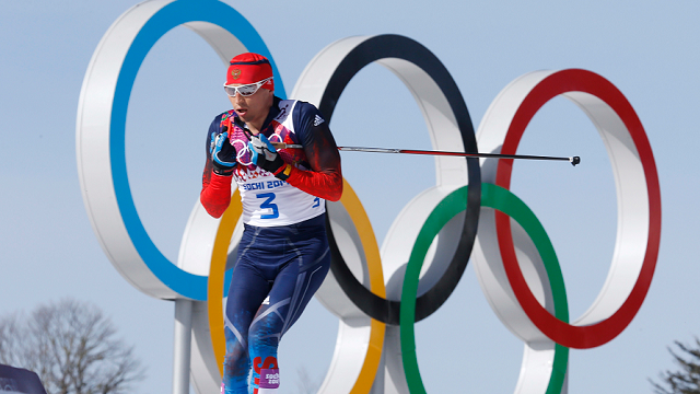 In this Feb. 23, 2014 file photo Russia's gold medal winner Alexander Legkov skis past the Olympic rings during the men's 50K cross-country race at the 2014 Winter Olympics in Krasnaya Polyana, Russia. (AP Photo/Dmitry Lovetsky)