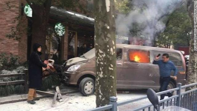 18 injured after 'burning van' crashes into pedestrians in Shanghai