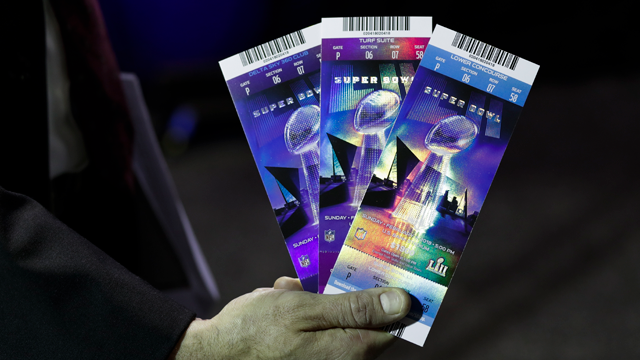 Michael Buchwald, senior counsel, legal affairs for the NFL, holds Super Bowl 52 tickets during a news conference Thursday, Feb. 1, 2018, in Minneapolis. (AP Photo/Matt Slocum)