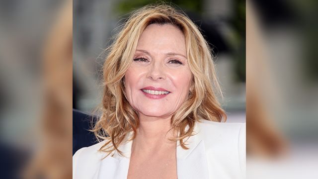 Actress Kim Cattrall poses for photographers upon arrival to the British Academy Television Awards at the Royal Festival Hall in London, Sunday, May 14, 2017. (Photo by Joel Ryan/Invision/AP)