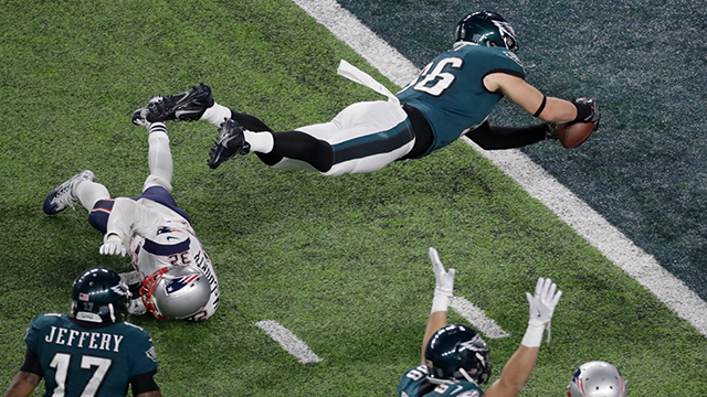 (AP Photo/Eric Gay) Philadelphia Eagles tight end Zach Ertz scores past New England Patriots free safety Devin McCourty during the second half of the NFL Super Bowl 52 football game Sunday, Feb. 4, 2018, in Minneapolis.
