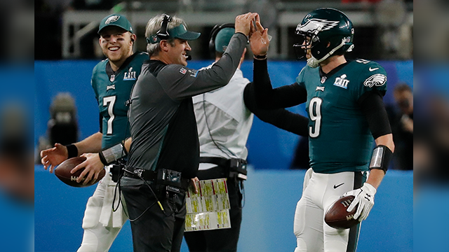 Philadelphia Eagles quarterback Nick Foles (9) celebrates a touchdown with head coach Doug Pederson, during the first half of the NFL Super Bowl 52 football game against the New England Patriots, Sunday, Feb. 4, 2018, in Minneapolis. (AP Photo)