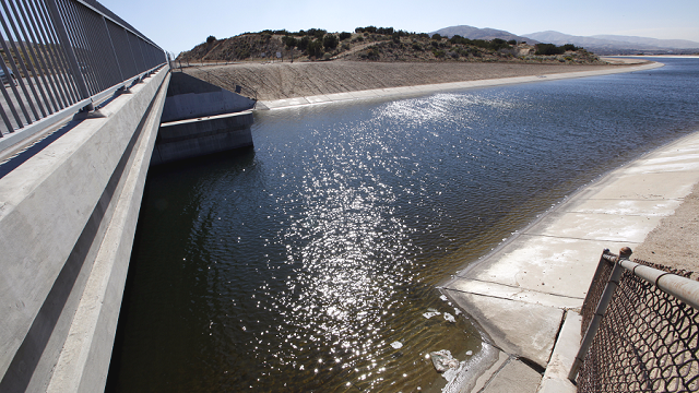 The California Aqueduct is seen as it passes through Palmdale, Calif., in Southern California's Antelope Valley. (AP Photo/Reed Saxon)