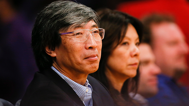 (AP Photo/Danny Moloshok) Dr. Patrick Soon-Shiong sits courtside as the Los Angeles Lakers play against the Utah Jazz during the second half of an NBA basketball game in Los Angeles, Tuesday, Feb. 11, 2014.