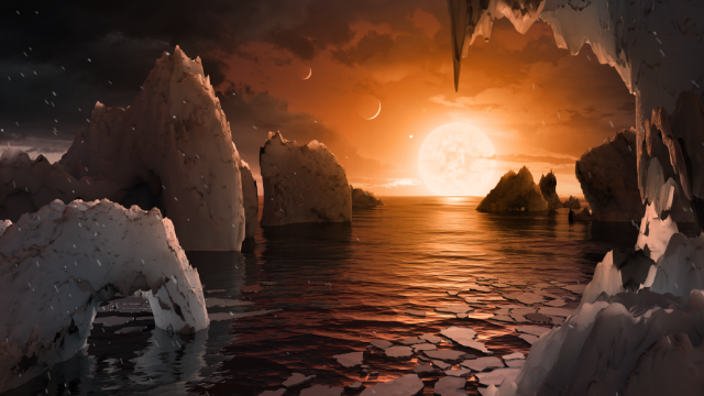 This illustration shows the possible surface of TRAPPIST-1f, one of the newly discovered planets in the TRAPPIST-1 system. (Credits: NASA/JPL-Caltech)