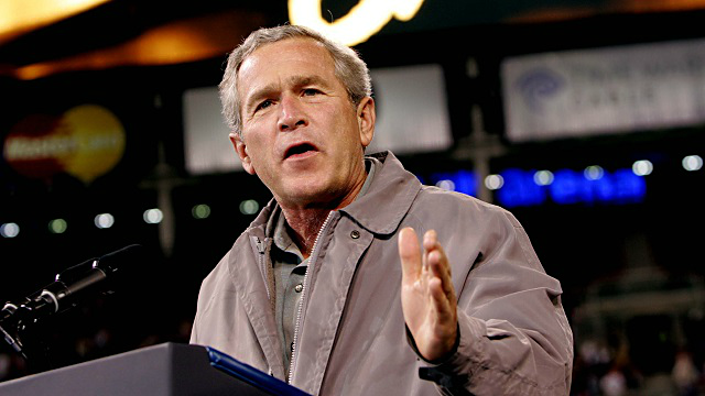 In this Oct. 31, 2004, file photo, President George W. Bush speaks at a campaign rally at the Great American Ball Park in Cincinnati. (AP Photo/Pablo Martinez Monsivais, File)