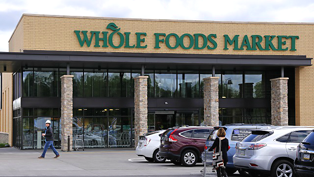 This May 3, 2017, photo, shows a Whole Foods Market grocery store, in Upper Saint Clair, Pa. (AP Photo/Gene J. Puskar)