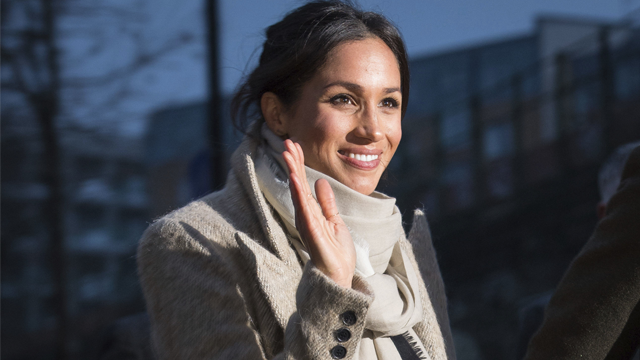 Meghan Markle waves to the crowd as she leaves after a visit with Britain's Prince Harry to the Reprezent 107.3 FM radio station in Brixton, south London, Tuesday, Jan. 9, 2018. (AP Photo/ Dominic Lipinski, Pool)