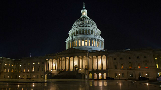 The U.S. Capitol in Washington on Thursday night, Feb. 8, 2018. The Senate passed a budget deal and spending measure to reopen the shuttered federal government early Friday morning, sending the bill to the House. (AP Photo/Jon Elswick)