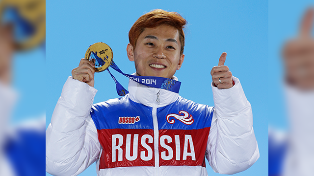 In this Feb. 15, 2014, file photo, men's 1,000-meter short track speedskating gold medalist Viktor Ahn, of Russia, gestures while holding his medal during the medals ceremony at the Winter Olympics in Sochi, Russia.