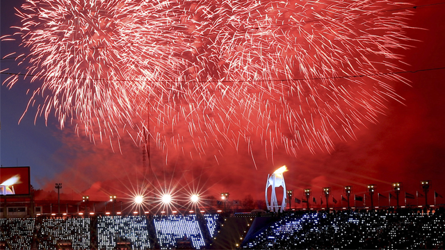 Fireworks go off after the Olympic flame was lit during the opening ceremony of the 2018 Winter Olympics in Pyeongchang, South Korea, Friday, Feb. 9, 2018.  (Sean Haffey/Pool Photo via AP)