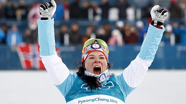 Bronze medal winner Krista Parmakoski, of Finland, celebrates during the winners ceremony after the women's 7.5km /7.5km skiathlon cross-country skiing competition at the 2018 Winter Olympics, Saturday, Feb. 10, 2018.(AP Photo/Matthias Schrader)