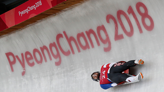 Chris Mazdzer of the United States speeds past the Olympic rings during the men's luge training run ahead of the 2018 Winter Olympics in Pyeongchang, South Korea, Friday, Feb. 9, 2018. (AP Photo/Andy Wong)