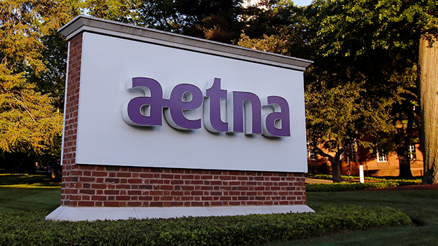 FILE - This Thursday, June 1, 2017, file photo shows a sign on the campus of the Aetna headquarters in Hartford, Conn. Aetna Inc. reports earnings Tuesday, Jan. 30, 2018. (AP Photo/Bill Sikes, File)