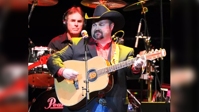 "(Photo by Frank Micelotta/Invision/AP, File). FILE - In this Nov. 22, 2013 file photo, Daryle Singletary performs at a tribute to George Jones in Nashville, Tenn. Singletary, who sang songs like ""I Let Her Lie"" and ""Too Much Fun,"" died Monday, Feb. 12,..."