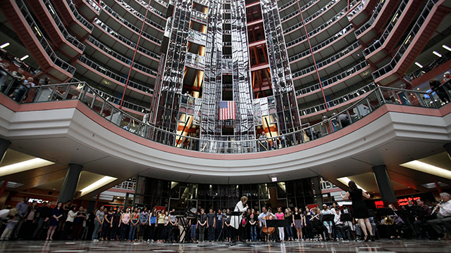 (AP Photo/Kiichiro Sato, File) FILE - In this March 19, 2013 file photo, soprano Renee Fleming performs with world-famous cellist Yo-Yo Ma and a choir of dozens of high school students in the rotunda of the James R. Thompson Center in Chicago.