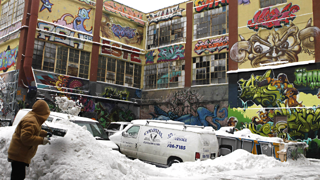 In this Jan. 26, 2011 file photo, a man shovels snow to clear a driveway near 5pointz graffiti art gallery. (AP Photo/Frank Franklin II, File)