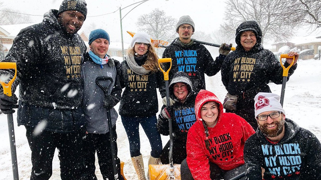 Volunteers help shovel snow for the elderly on the South Side of Chicago. (Source: Jahmal Cole)