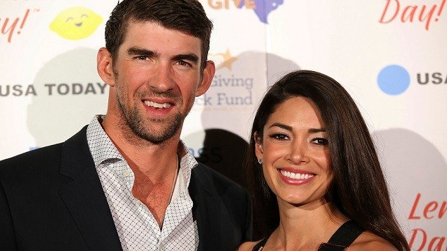 Michael Phelps and wife Nicole Johnson pose for a photograph on the red carpet for the Big Game Big Give event in Houston on Saturday, Feb. 5, 2017. (AP Photo/John Carucci)