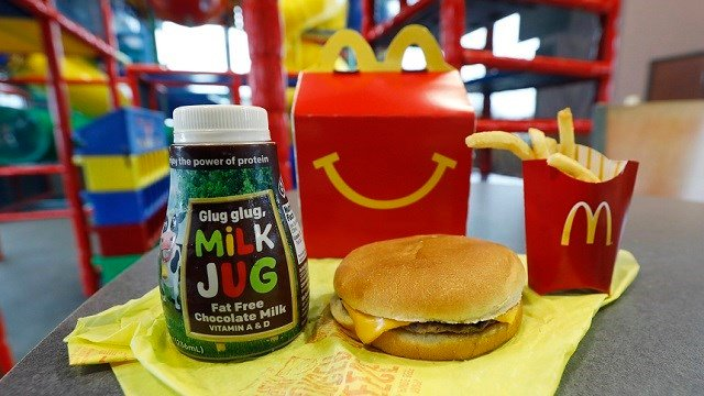 A Happy Meal featuring non-fat chocolate milk and a cheeseburger with fries, are arranged for a photo at a McDonald's restaurant in Brandon, Miss., Wednesday, Feb. 14, 2018. (AP Photo/Rogelio V. Solis)