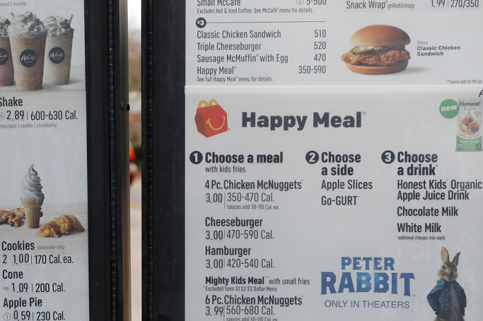 A portion of a drive thru menu panel featuring Happy Meals is seen at a McDonald's Restaurant in Ridgeland, Miss., on Wednesday, Feb. 14, 2018. (AP Photo/Rogelio V. Solis)