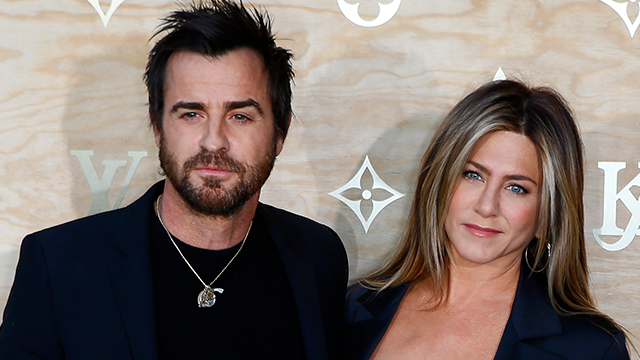 (AP Photo/Francois Mori) US actor Justin Theroux, left and his wife US actress Jennifer Aniston pose during a photocall ahead of a diner for the launch of a Louis Vuitton leather goods collection in collaboration with US artist Jeff Koons, at...