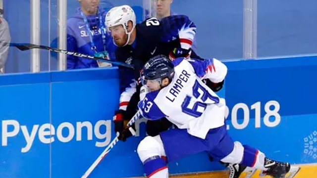 (AP Photo/Frank Franklin II). Patrik Lamper (63), of Slovakia, checks James Wisniewski (21), of the United States, during the first period of the preliminary round of the men's hockey game at the 2018 Winter Olympics in Gangneung, South Korea, Friday, ...