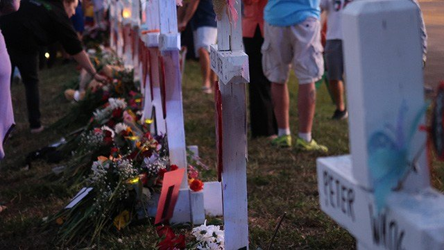 A memorial is set up at Marjory Stoneman Douglas High days after a shooting took place at the school located in Parkland, Florida.