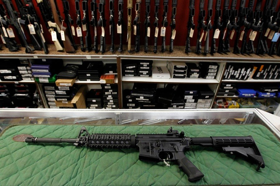 In this Thursday, July 26, 2012 file photo, an AR-15 style rifle is displayed at the Firing-Line indoor range and gun shop. (AP Photo/Alex Brandon, File)