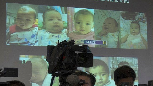 In this Aug. 12, 2014, file photo, the media attend a press briefing where Thai police display projected pictures of surrogate babies born to a Japanese man who is at the center of a surrogacy scandal. (AP Photo/Sakchai Lalit, File)