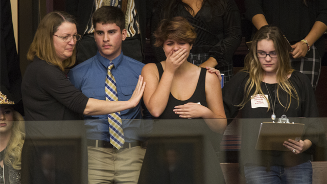 Sheryl Acquarola, a 16 year-old junior from Marjory Stoneman Douglas High School is overcome with emotion after the representatives voted not to hear the bill banning assault rifles and large capacity magazines. (AP Photo/Mark Wallheiser)
