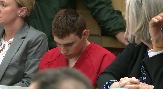 Nikolas Cruz appears in court for a status hearing before Broward Circuit Judge Elizabeth Scherer in Fort Lauderdale, Fla., Monday, Feb. 19, 2018. (WPLG via CNN, POOL)